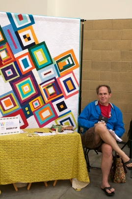 Scott Griffin, showing off the Ventura Modern Quilt Guild Opportunity Quilt